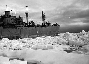The Naval ship S.S. Jonathan Harrington surrounded by Arctic sea ice.