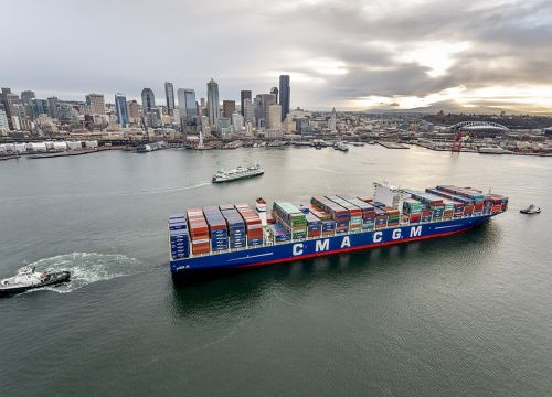 The massive container ship Benjamin Franklin pulls into the Port of Seattle.