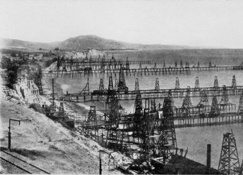 Black & white photo of early oil derricks & piers at Summerland, California 1902