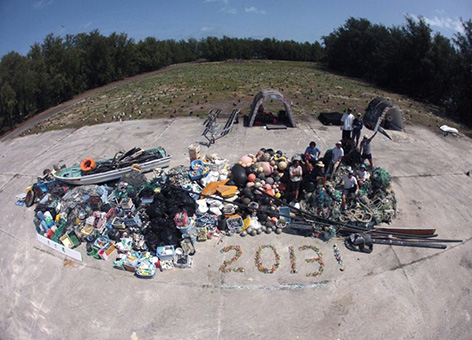 In 2013, a NOAA team collected 14 metric tons of marine debris from Midway Atoll