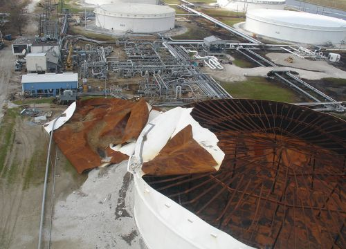 A Chevron oil terminal's storage tank with severe damage on top.