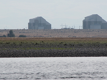 Two of Hanford's nuclear reactors sit decommissioned along the Columbia River.