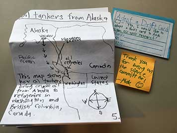 A hand-drawn map of oil tanker travel, a thank-you note, and a donation letter.