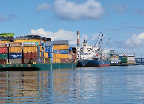 Ships and shipping containers on the Duwamish River in Seattle.