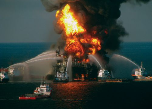 Deepwater Horizon oil rig on fire in Gulf of Mexico with firefighting boats.