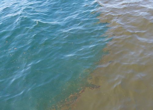 Edge of oil slick at ocean surface.
