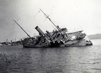 NOAA Fathomer aground on a coral reef in the Philippines after a typhoon in 1936