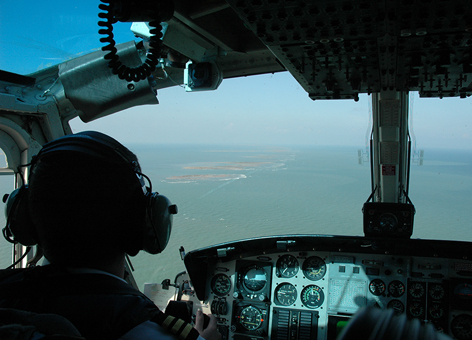 Pilot looking out airplane to Gulf of Mexico.