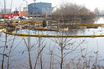 Containment boom surrounds the oil and debris released from tanks in New Jersey.
