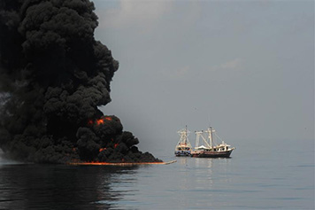 Photo: In situ burn with vessels looking on.