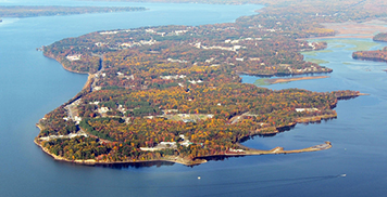 Aerial view of Naval Support Facility Indian Head surrounded by water.