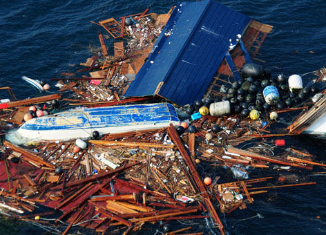 Aerial view of scattered debris in the water.