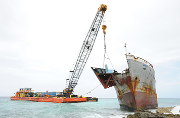 Sections of the Jireh's hull are removed to lighten the vessel.