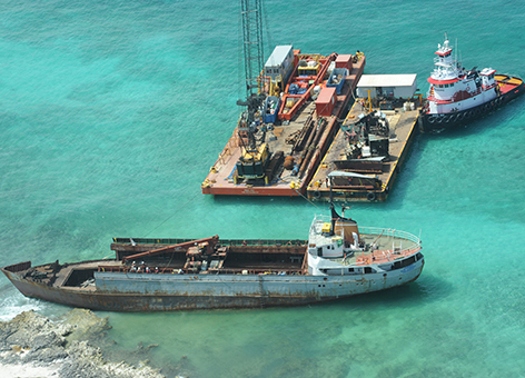 Response barges are anchored near the grounded M/V Jireh.