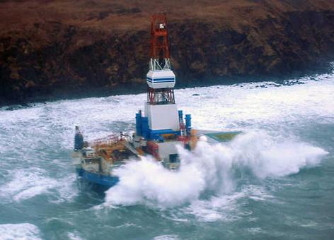 Waves crash over the grounded mobile drilling unit Kulluk.