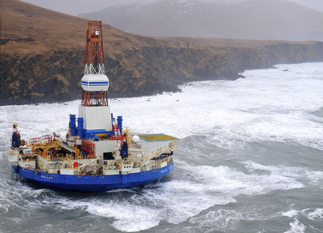 Rocky coast and habitats adjoin the grounded conical drilling unit Kulluk.
