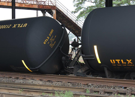 Derailed oil tanker cars up close.