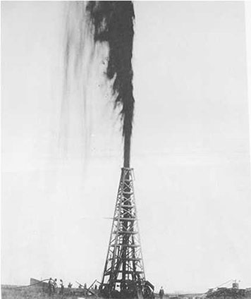 An oil derrick shoots oil 100 feet in the air at Spindletop Hill in 1910.