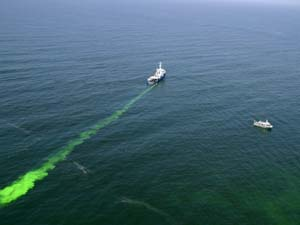 A vessel releases nontoxic green dye off San Francisco during a 2006 drill.