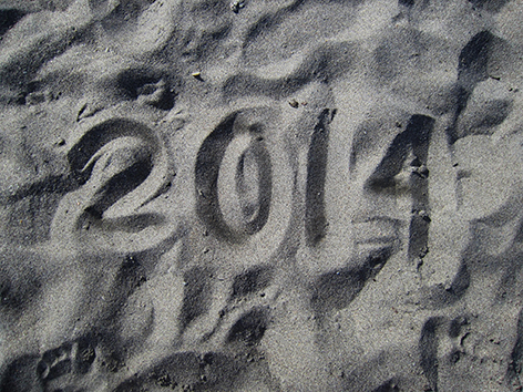 2014 written in the sand.