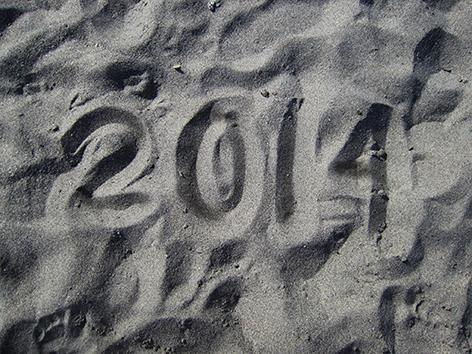 2014 written in the sand.