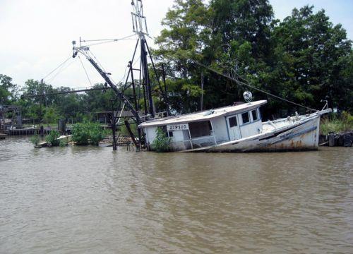Boat half-sunk in Vermilion Bay, Lousiana.