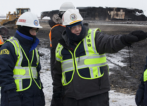 National Transportation Safety Board officials at N.D. train accident scene.