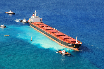 The 734-foot bulk carrier M/V VogeTrader after it ran aground in Hawaii in 2010.