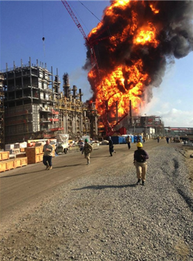 Fireball explosion at Louisiana chemical facility with people running.