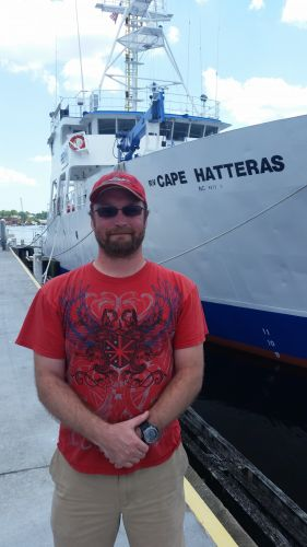 Clif Huff stands in front if the R/V Cape Hatteras.
