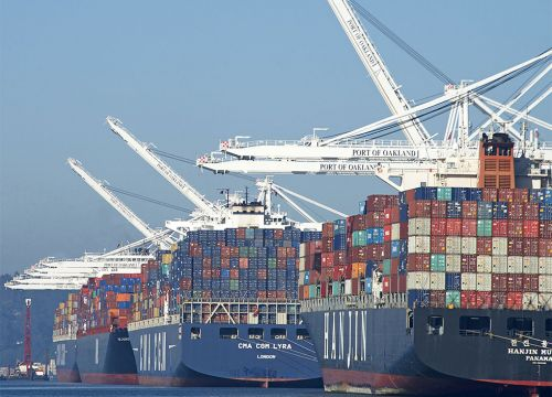 Large ships with cargo containers.