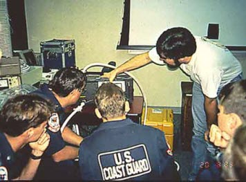 Photo: A NOAA instructor demonstrates the use of a fluorometer.