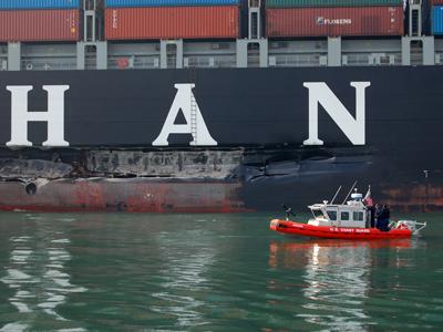 Cosco Busan ship with Coast Guard vessel.