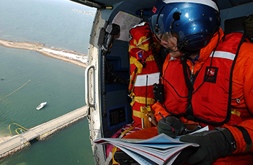 Photo: Responder in helicopter.