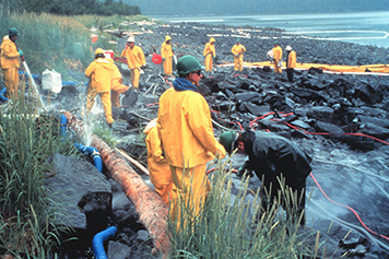Photo: Shoreline cleanup following Exxon Valdez oil spill.