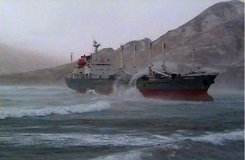 M/V Kuroshima aground after dragging anchor.
