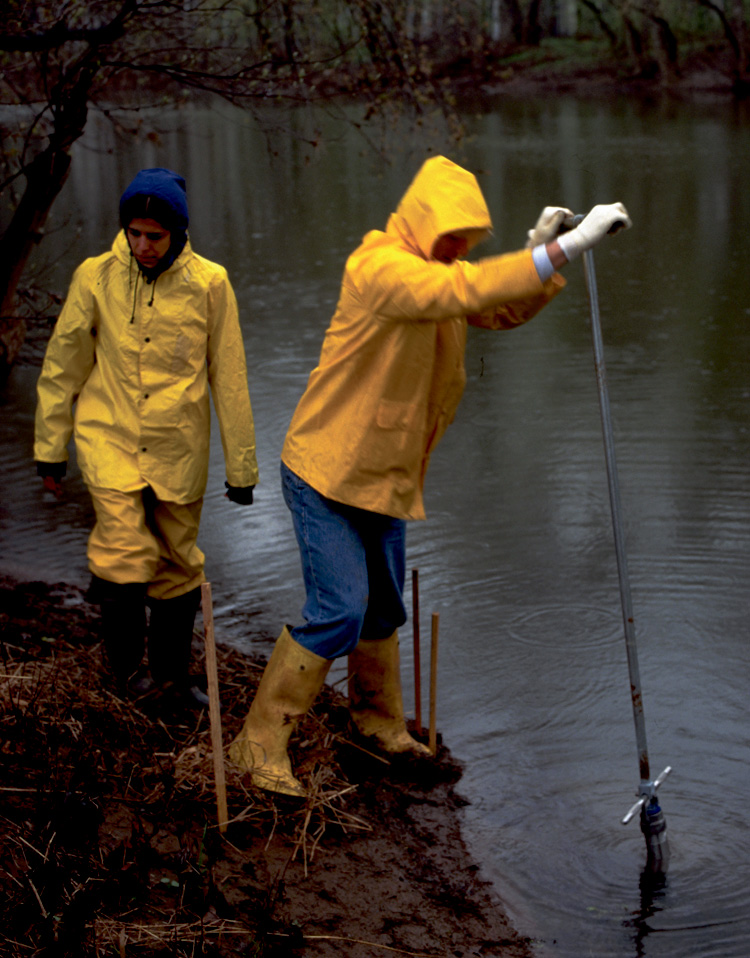 Scientists sampling sediments at Federal Creosote Superfund site.