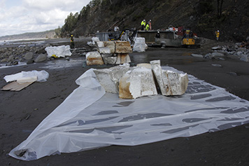 Staging the dock's plastic foam for transport, when it was transferred off the coast via helicopter.