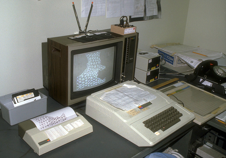 Apple II+ computer hooked up to Apple graphics tablet, color TV, and printer.
