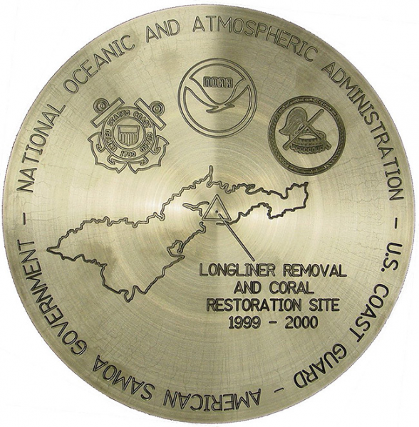 "A commemorative medal that reads ""National Oceanic and Atmospheric Administration. U.S. Coast Guard. American Samoa Government. Longliner Removal and Coral Restoration Site 1999-2000."""