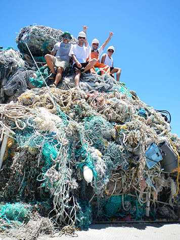 NOAA collected nearly 50 metric tons of marine debris, piled on ship's deck.
