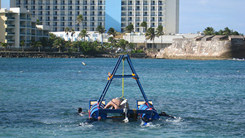 Transporting the premade cement reefs to set up the underwater educational coral reef trails in front of a public beach.