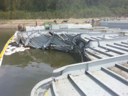 Close-up view of damaged barge.