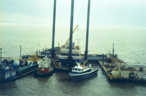 Several vessels at a dock.