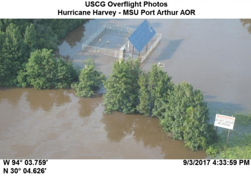 Treetops visible in a flooded area.