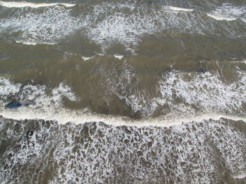 Overhead view of oil in the surf.
