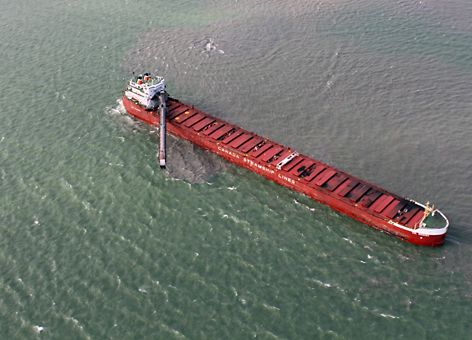 Long cargo vessel in water.