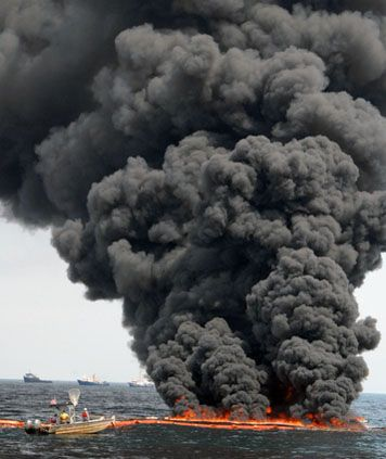 Image of a controlled burn of oil spilled in the Gulf of Mexico in 2010.