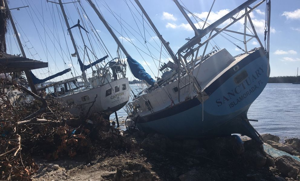Two grounded and wrecked sailboats.