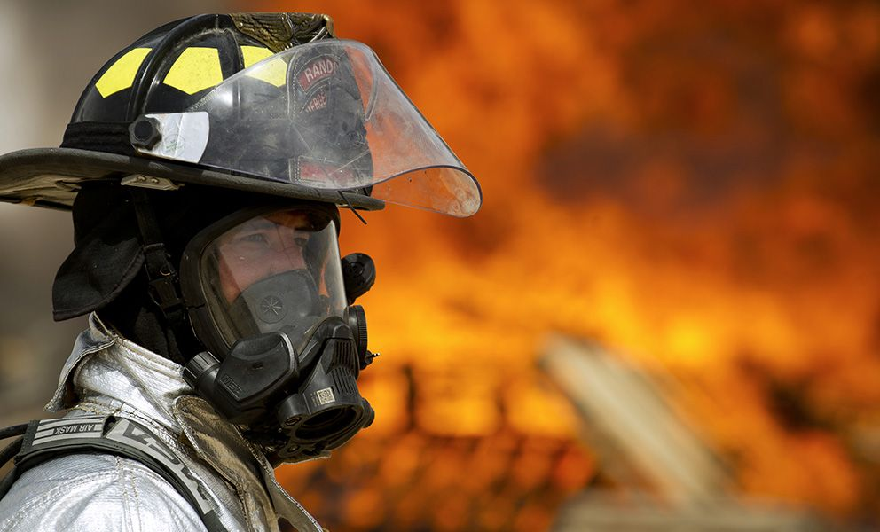 Firefighter in front of a fire.